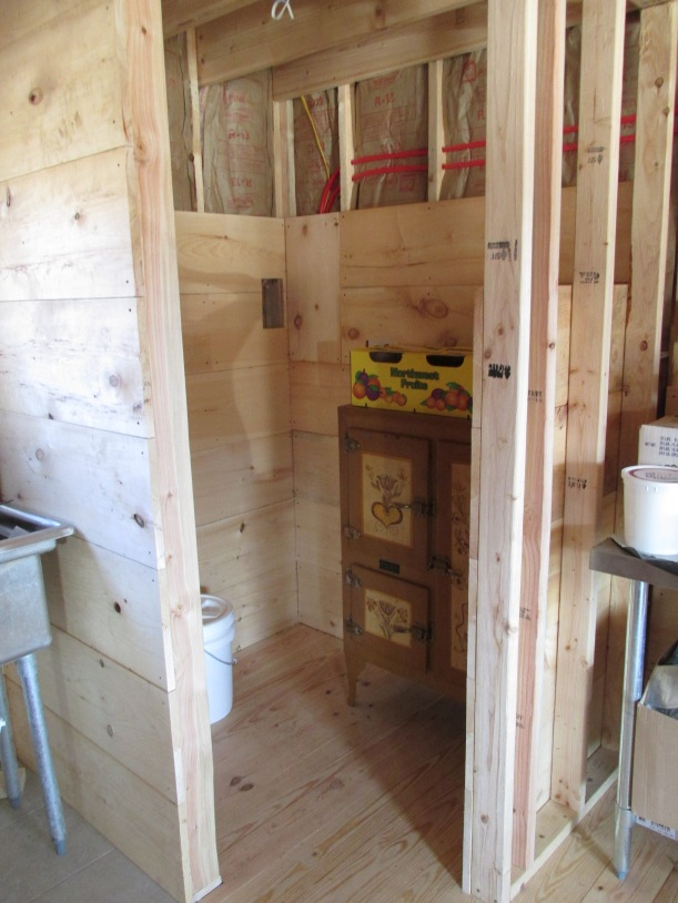 The pantry is almost walled in.